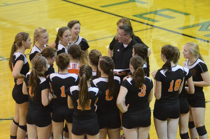 Coach Mike Howard talks to his Warsaw volleyball team prior to the third set Thursday night at Concord.