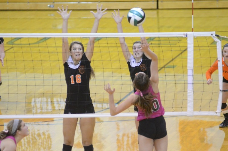 Jordyn Lindeman (left) and Laura Craig of Warsaw go up to block the shot of Concord's Francesca Rodino Thursday night. The Tigers beat the hosts 3-0 in NLC action (Photos by Scott Davidson)