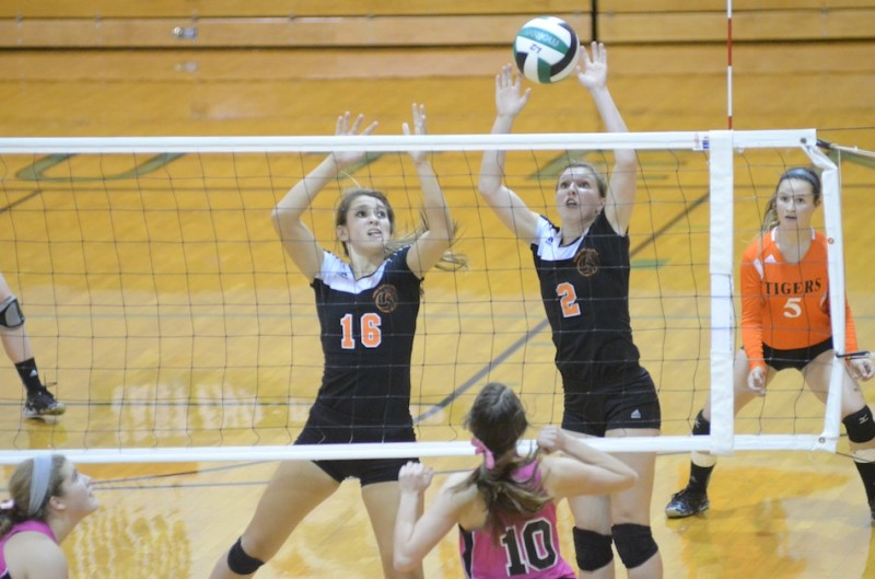 Warsaw senior Laura Craig blocks the ball versus Concord in a recent match. Craig helped the Tigers place second Saturday in the Clinton Prairie Invitational (File photo by Scott Davidson)