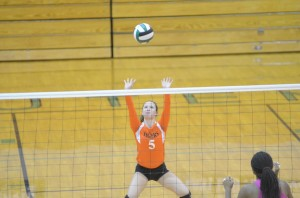 Sophomore libero Peyton Adamiec passes the ball up for Warsaw during a win at Concord Thursday night.