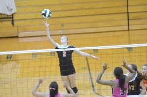 Senior Laura Craig reaches to tip the ball for Warsaw.