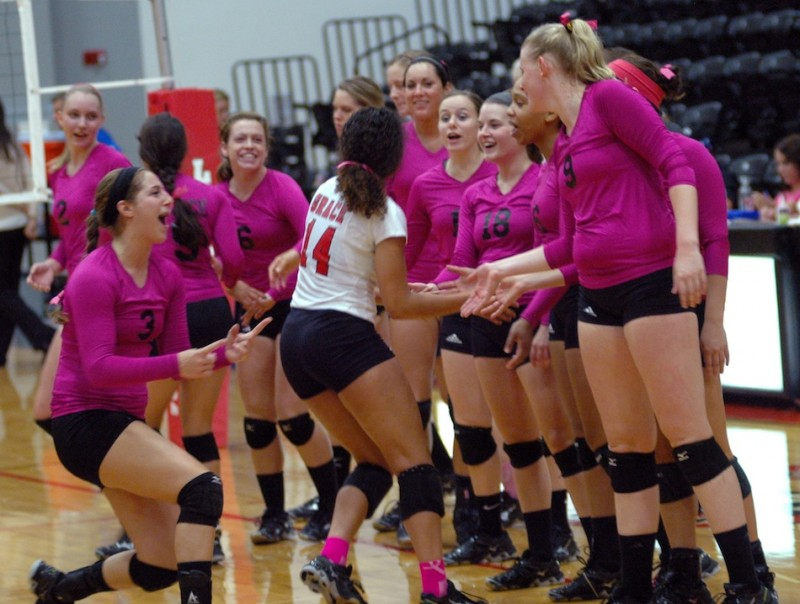 The Grace College volleyball team celebrates during a home win Saturday (Photo provided by Grace College Sports Information Department)