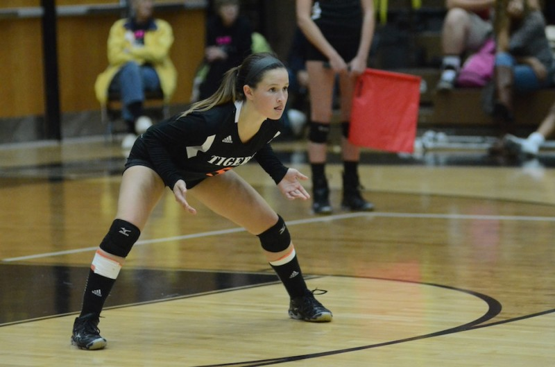 Warsaw libero Peyton Adamiec readies for a play in a recent match. Adamiec helped the Tigers rally to edge Fort Wayne Carroll 3-2 Wednesday night (File photo by Scott Davidson)
