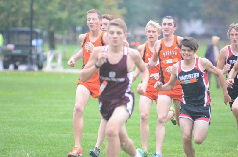 A trio of Warsaw runners jockey for position early on at the Culver Academies Sectional Tuesday night.