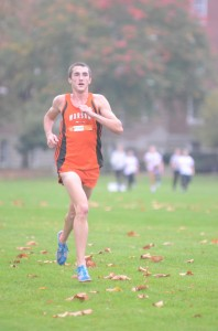 Warsaw senior Ellis Coon nears the finish line Tuesday night at the Culver Academies Sectional. Coon won the race in 16:28.