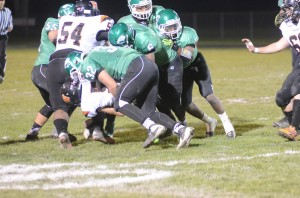 Concord linebacker Jake Kronk makes a stop on Warsaw reciever Conner McCammack.