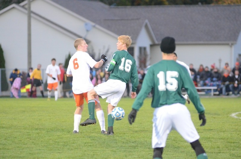 Warsaw's Sam Allbritten battles Steven Hooley of Northridge during the regional championship game. The No. 9 Tigers face No. 4 Crown Point Saturday at noon in the Class 2-A Warsaw Semistate (File photo by Scott Davidson)