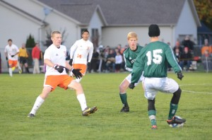 Sam Allbritten steps in to defend for Warsaw as Elliott Laughlin looks to pass the ball for Northridge.