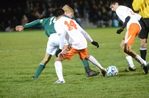 Miguel Rivera (No. 14) of Warsaw tries to take the ball from Steven Hooley of Northridge. At right is Tito Cuellar, who scored the game winner for the Tigers.