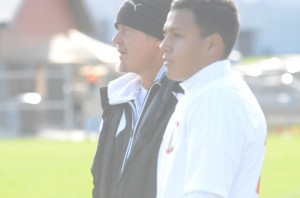 Warsaw boys soccer coach Scott Bauer and Manuel Rodriguez watch semi state action Saturday.