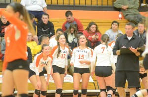 The Warsaw bench celebrates during sectional play Saturday.