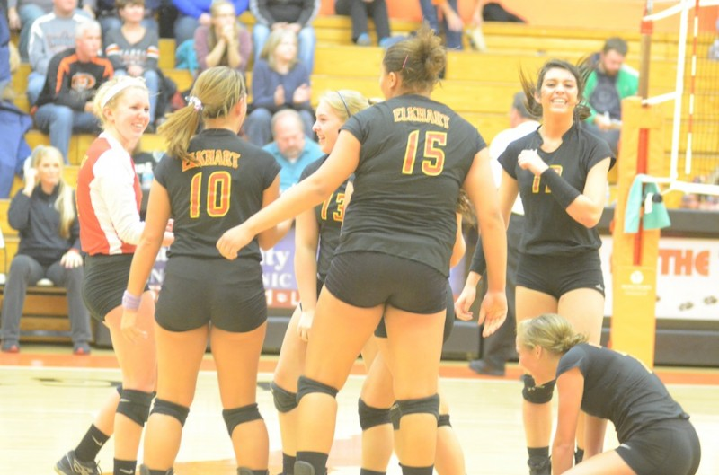 Elkhart Memorial celebrates after rallying to beat host Warsaw 3-2 in volleyball sectional semifinal action.