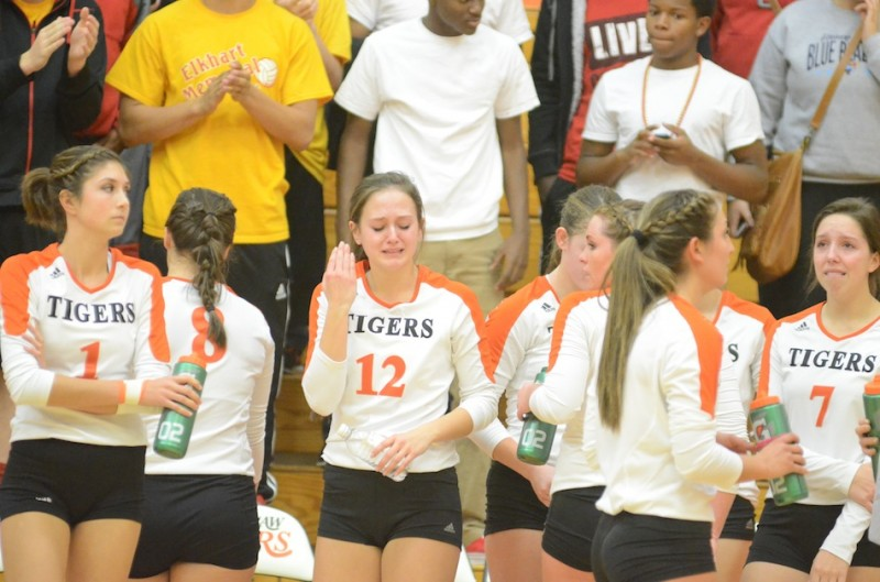 Warsaw senior Delaney Goble shows her emotions after a 3-2 loss to Elkhart Memorial in volleyball sectional semifinal play Saturday at Warsaw (Photos by Scott Davidson)