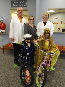 Pictured are costume contest winners Landon Smith and Taylor Schreck. In back are Mike Taylor, MedStat physician assistant; Tammy Cotton, Syracuse Wawasee Chamber of Commerce executive director; Laura Wheeler, MedStat Nurse Practitioner.