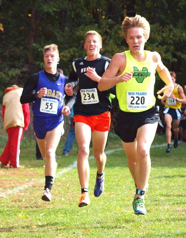 Tyler Houvener, center, turned in another strong performance for No. 9 Warsaw Saturday. The Tigers placed second in the New Prairie Semistate to earn a spot in the State Finals.