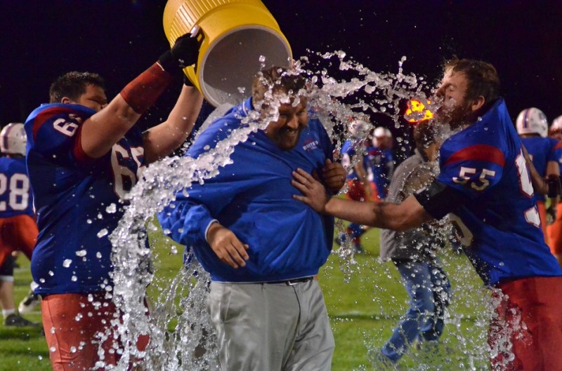 First-year Whitko head coach Josh Mohr earns a treatment that every coach dreams of: The Gatorade bath. (Photos by Nick Goralczyk)
