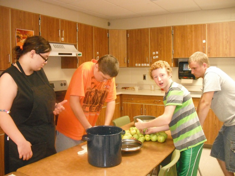 From left, Stacie Castle, Zachary Craig, Derek Dunithan and Michael Turner are making applesauce in a kitchen at Wawasee High School. (Photo provided)