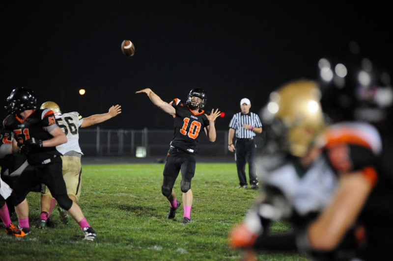 Warsaw quarterback Austin Head looks to keep his team in the race for a conference title Friday night. The Tigers host NorthWood in NLC action (File photo by Mike Deak)