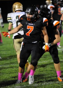 Warsaw's Ethyn Bradley celebrates versus Wawasee earlier this season. The Tigers will play Fort Wayne Northrop in a sectional semifinal game Oct. 25 (File photos by Mike Deak)