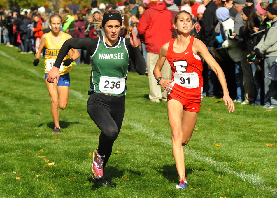 Wawasee's Bre Robinson and Fremont's Riley Welch battle at the finish line of the New Haven Girls Cross Country Semi-state Saturday afternoon. (Photos by Mike Deak)
