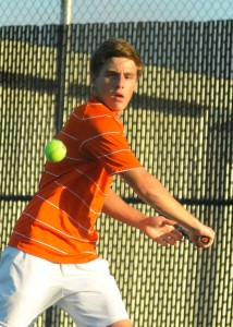 Senior Evan Miller rolled to a win at No. 3 singles Tuesday as Warsaw beat Culver Academies 3-2 in a regional semifinal (File photos by Mike Deak)