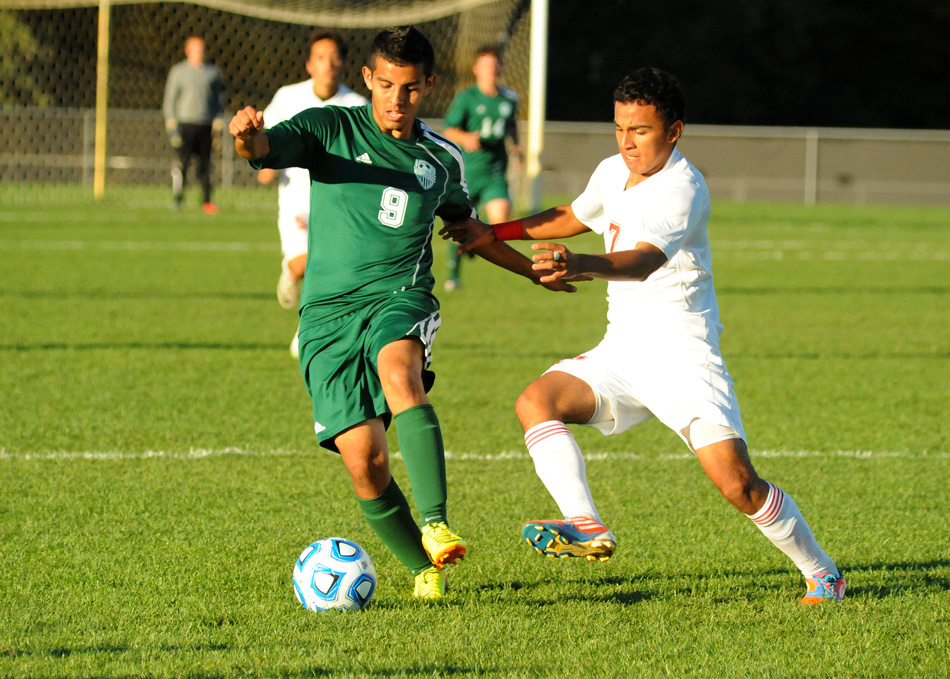 Wawasee's Fernando Camargo dribbles past Plymouth's Antonio Calderon during the first game of the Warsaw Boys Soccer Sectional Monday night. Plymouth won 3-1. (Photos by Mike Deak)