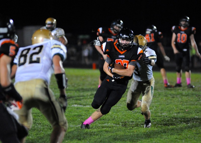 Warsaw's Chad Goon makes a play during a win over Wawasee earlier this season. The Tigers play at No. 8 Concord Friday night for the NLC championship (File photo by Mike Deak)