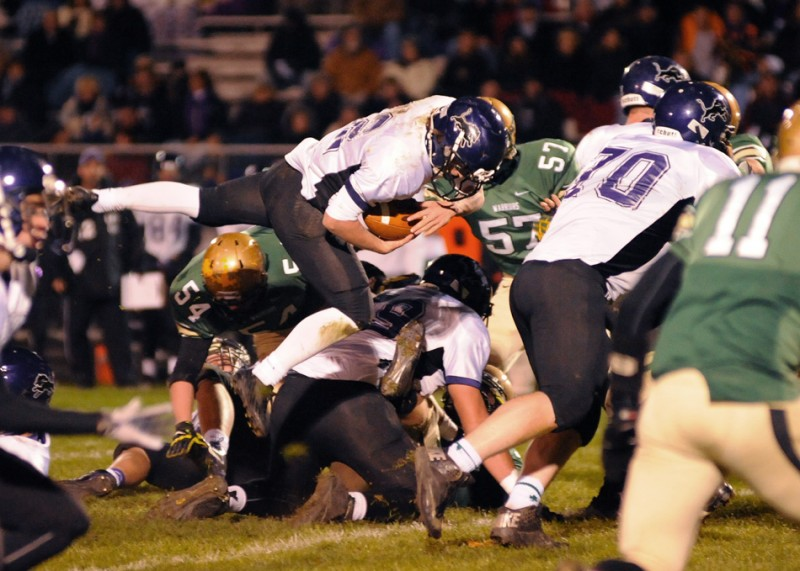 Leo running back Logan Leiter hurdles over the Wawasee defense.