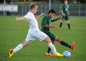 Wawasee's Harvey Lopez tries to hold off Plymouth's Kameron Ray.