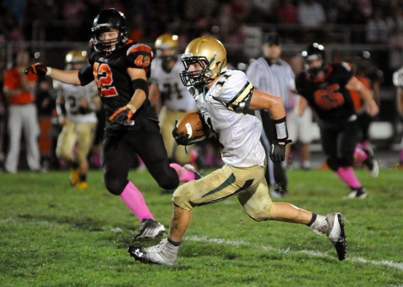 Austin Lutz flies upfield for Wawasee in a game at Warsaw Oct. 4. The Warriors host No. 7 and undefeated Leo in a Class 4-A sectional opener Oct. 25.