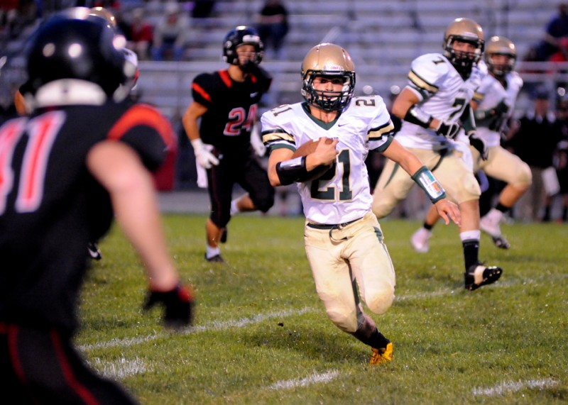 Brandin McCulloch rambles for a gain for Wawasee earlier in the season. The Warriors play at winless Goshen in the regular-season finale Friday night (File photo by Mike Deak)