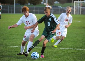 Rasmus Rich of Wawasee is closed in by Plymouth's Kyle Barry.
