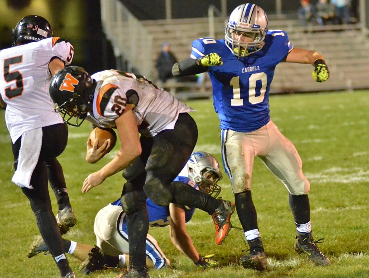 Carroll's Alex Bartkus body checks Warsaw's Tristan McClone out of bounds in the fourth quarter of Carroll's 42-7 win. (Photos by Nick Goralczyk)