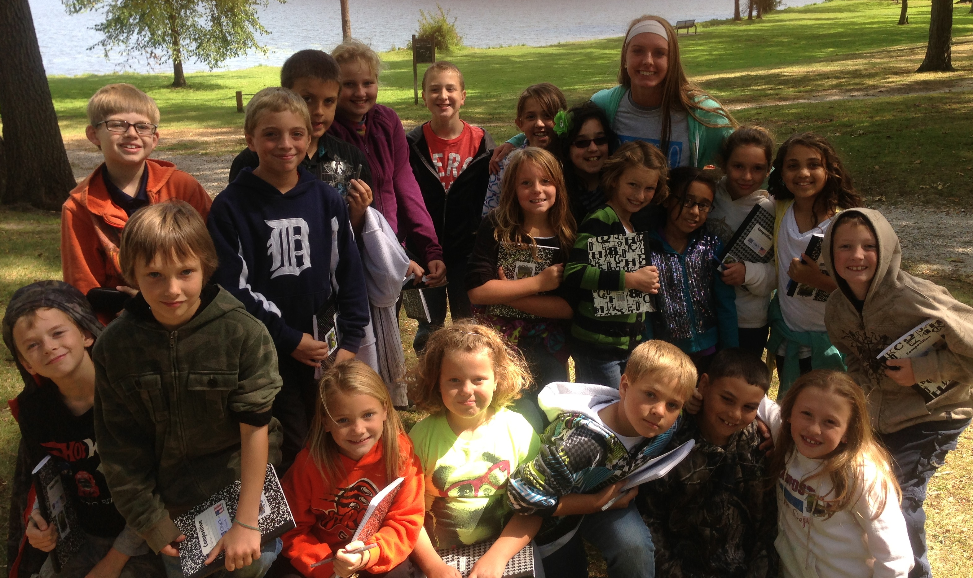 Mrs. Fleming's class stands with Grace College student and Eisenhower Alumni Meredith Hollar.   (Photo provided)