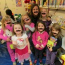 Miss Heidi Warstler and friends posed for this picture with their mustaches on.  The theme for last week's story time was Hair, Hair, Everywhere! Our last story time will be on at 10:15 a.m. or 1:30 p.m. Wednesday, Nov. 27. (Photo provided)