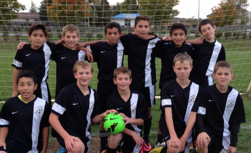 The Warsaw Travel '02 U12 soccer team shown above finished its fall season undefeated (Photo provided by Shirley Fleming)