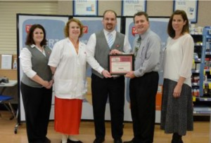 Pictured in the photo of Walgreens (from left): Danielle Renbarger, Walgreens Assistant Manager; Jennifer Hoover, Walgreens Pharmacy Manager; Jonathan Goss, Walgreens Manager; Mark Dobson IOM, President and CEO Warsaw Kosciusko County Chamber; and Renea Salyer Member Relations Coordinator Warsaw Kosciusko County Chamber.  (Photo provided)