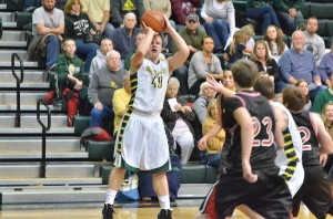 Wawasee's Alex Clark shoots for two against Manchester on Friday night. Clark led all scorers with 13 points. (Photos by Nick Goralczyk)