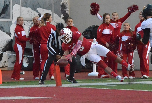 Indiana's Cody Latimer dives for the pylon for one of Indiana's eight touchdowns. Latimer led his team with 110 receiving yards.