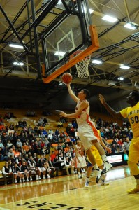 Rashaan Jackson goes up for two of his team-high 19 points for Warsaw (Photo by Amanda Farrell)