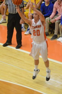 Senior Nate Pearl lets fly with a 3-point attempt for the Tigers.