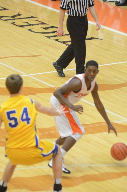Sophomore guard Paul Marandet looks for room for Warsaw as Homestead's Dana Batt defends.