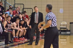 Squires head coach Eric Thompson looks on with some disdain for a call made by officials on Friday night.