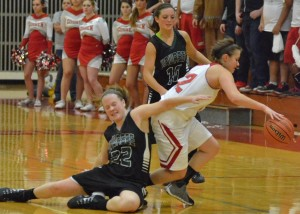 Elizabeth Jackson (10) and Hannah Haines (22) force a turunover on Goshen late in Friday's game.