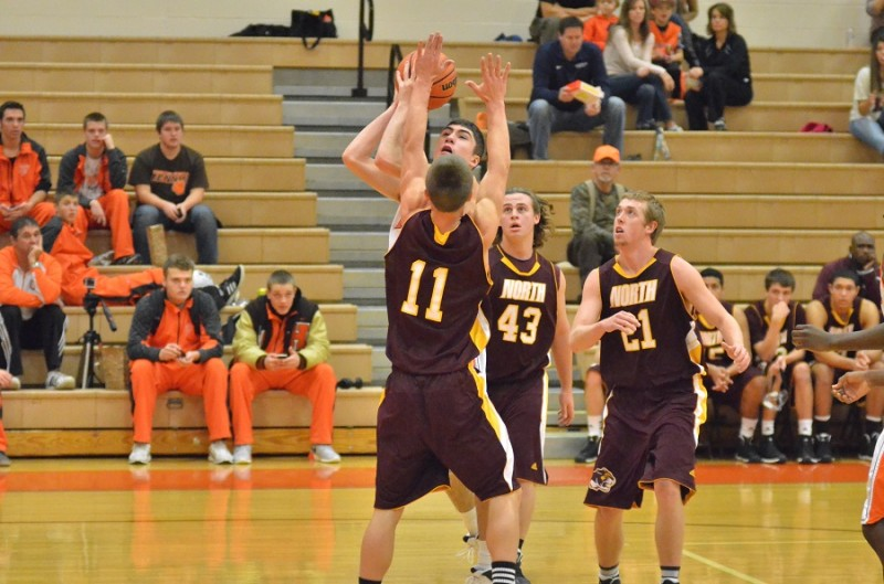 Jake Mangas goes up in traffic for Warsaw and makes contact with Grant Sims of Bloomington North.