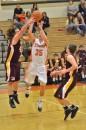 Jordan Stookey goes up for two in Friday morning's game. Stookey was one of three Tigers named to the all-tourney team.