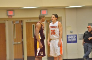 Bloomington North's Kaleb Ferrell tries some trash talking to try and break Warsaw's Jordan Stookey towards the end of Friday morning's game.