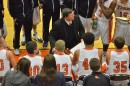 Coach Doug Ogle talks to his team during a timeout in Friday's opening round game.