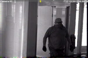 The suspect captured on camera during the July 12 robbery of Farmers State Bank. (Photo provided by KCSD)