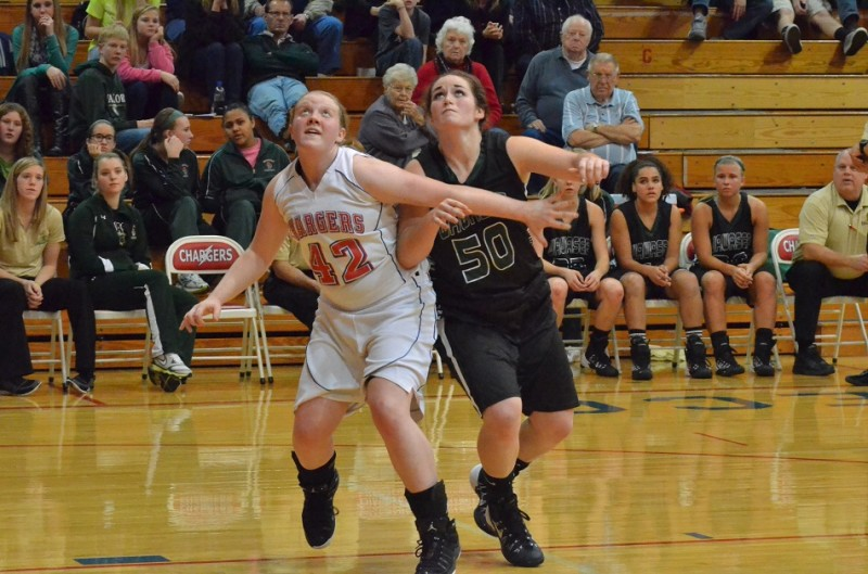 Taylor Fisher of West Noble and Wawasee's Katlyn Kennedy battle under the basket following a free throw. (Photos by Nick Goralczyk)
